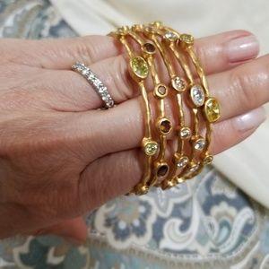Jewelry - Set of five golden bangle bracelets.